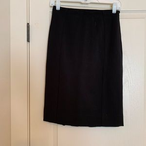 WHBM black pencil skirt with small ruffle back